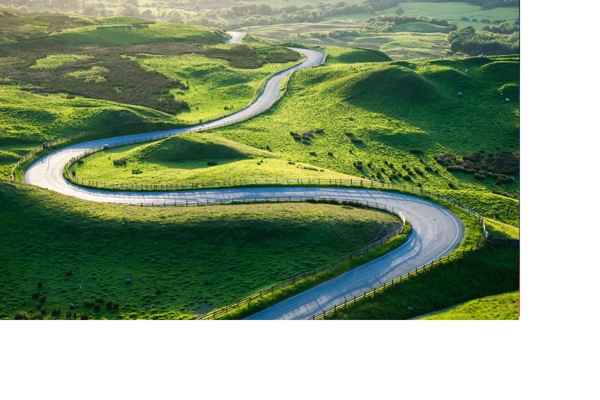 Scene of winding road and green rolling hills
